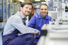 Cheerful Woman And Man Industrial Engineer At Work