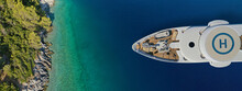 Aerial Drone Top View Ultra Wide Photo Of Large Yacht - Boat With Helicopter Landing Area Anchored In Tropical Exotic Paradise Bay With Turquoise Open Sea