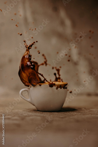Fototapeta cup of coffee with splash
