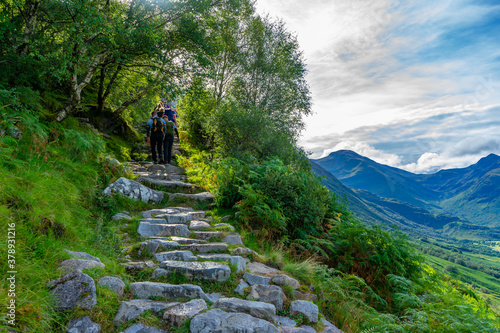 Fototapeta People walking up the hiking trail of Ben Nevis mountain, Scotland, UK with a beautiful view obraz
