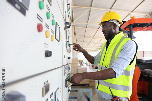 Fotografia, Obraz African American engineer is checking for power at main distribution board for t