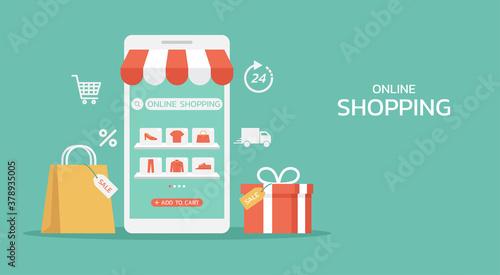 Obraz na plátne online shopping or digital store on mobile app concept with shopping bag, gift,
