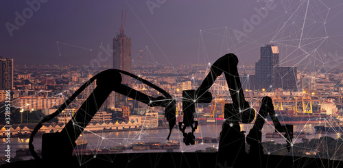 Foto Silhouette of modern automation robot arms with Ai assistant technology network concept and metropolis city building background