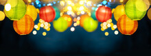 Festive Background With Colorful Lights Garland And Bright Bokeh. Holiday Light Decor. Celebration Concept.