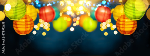 Fotografija Festive background with colorful lights garland and bright bokeh