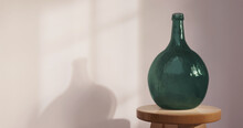 Empty Green Demijohn Bottle In...