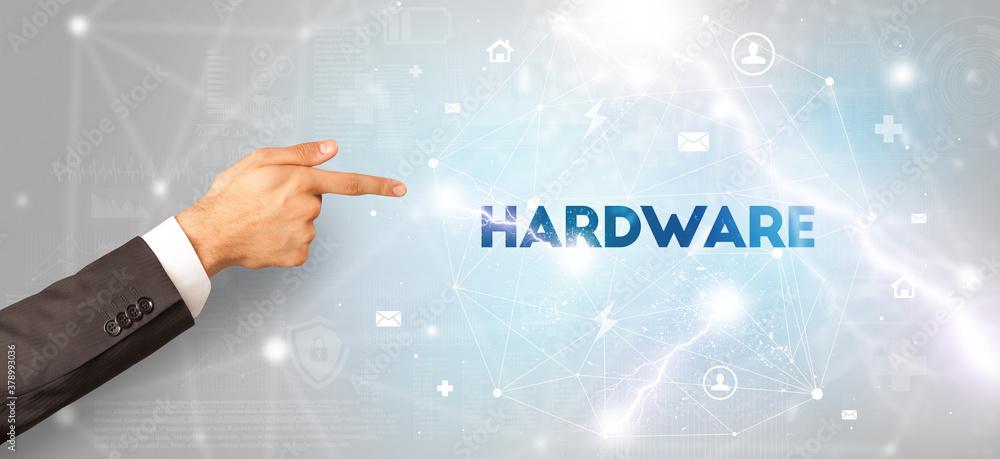 Fototapeta Hand pointing at HARDWARE inscription, modern technology concept