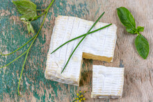 A Block Of Pont-l Eveque French Normandy Cheese Resting On Wooden Board