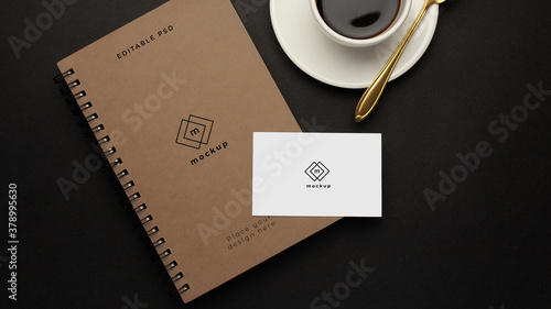 Leinwand Poster Notebooks mockup and visiting card with black cup of coffee on black background