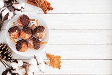 Autumn Acorn Shaped Donut Holes. Top View Side Border On A White Wood Background With Copy Space.