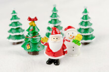 Merry Christmas And Happy New Year Concept. Cute Santa Claus Figure And Tree On Snow With Copy Space