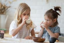 Two Little Sisters Drinking Ec...