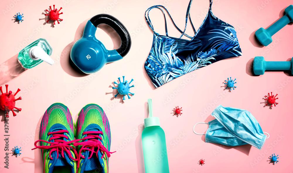 Fototapeta Fitness and coronavirus theme with workout set - flat lay