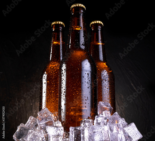 Cold beer with water drops, beer bottles with ice cubes Fototapet
