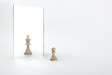 Reassessment Of Their Abilities. The Pawn Is Reflected In The Mirror Like A King