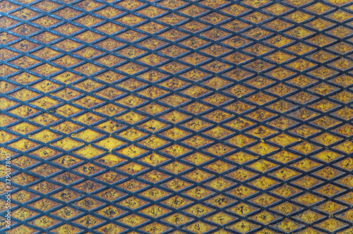metal grunge background covered with abraded yellow paint, rust Wallpaper Mural