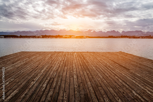 Water wooden pier on the lake at sunset time