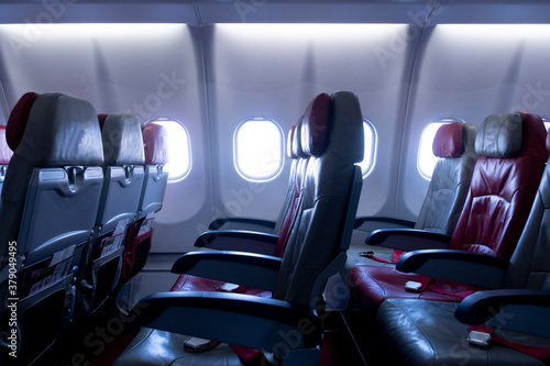 Photo Empty available seats on the aircraft in blue tone.