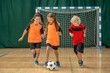 canvas print picture - Kids in sportswear running after the ball