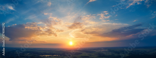 Spring rural landscape in the evening with beautiful burning sky, aerial view Canvas Print