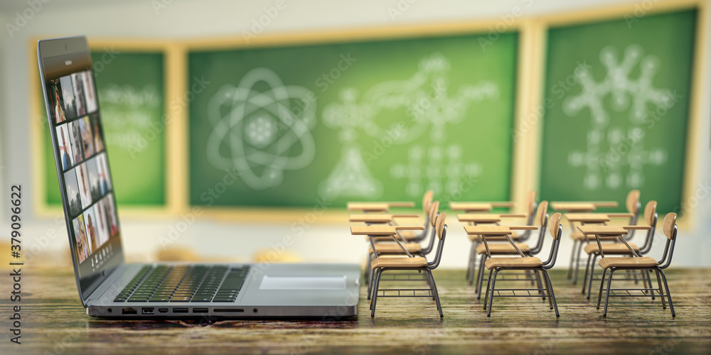 Fototapeta Online education and e-learning concept. Home quarantine distance learning. Laptop and school desks on blackdesk in classroom background.