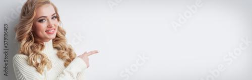Fototapeta Girl pointing to empty copy space obraz