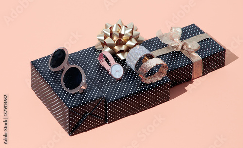 Fashion scene jewelry, sunglasses, watches and bracelets in isometric with gift box. Copy space. .Gift, date, shopping, online shopping, fashion blogger, sale concept