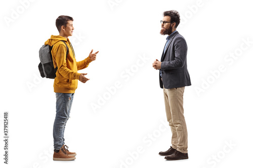 Obraz na plátne Full length profile shot of a male teenager talking to a beared man