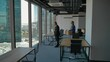 Happy businesspeople walk in new office, with boxes, smiling. Boss inviting his subordinated employes to new building. Wide 4k shot. Beautful window view.