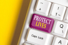 Conceptual Hand Writing Showing Protect Lives. Concept Meaning To Cover Or Shield From Exposure Injury Damage Or Destruction Colored Keyboard Key With Accessories Arranged On Copy Space
