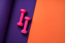 Pink Dumbbell And Purple Yoga ...