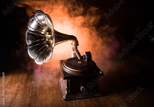 Old gramophone on a dark background. Music concept Wallpaper Mural