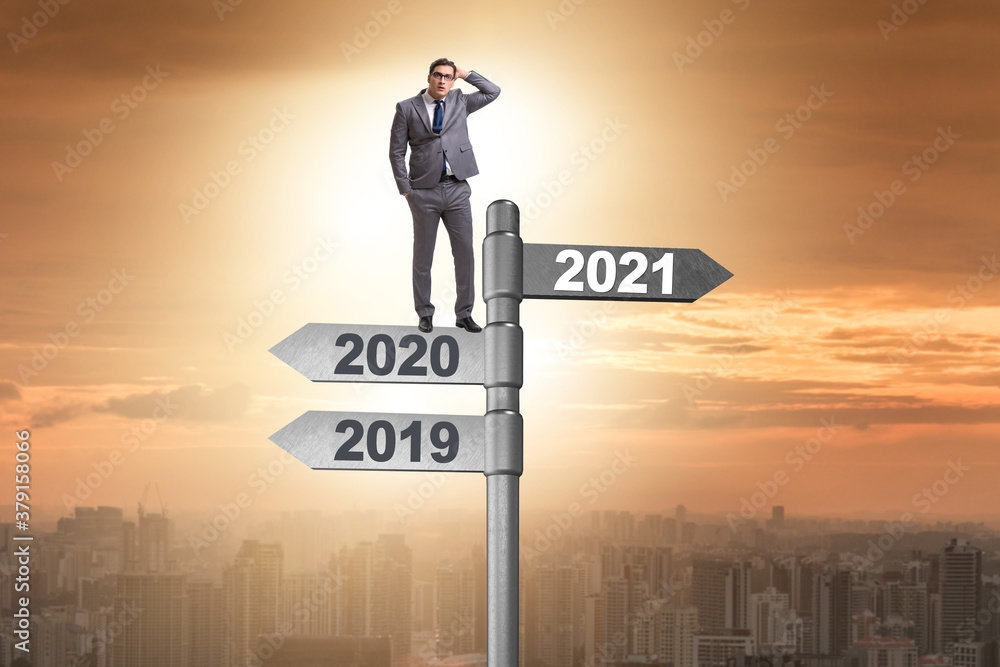 Fototapeta Road sign and businessman with 2020 and 2021