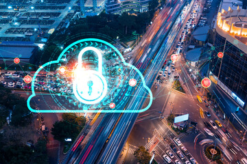 Padlock icon hologram on aerial view of road, busy urban traffic highway at night. Junction network of transportation infrastructure. The concept of success in cyber security intelligence.
