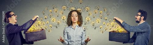 Fototapeta Two men sending ideas light bulbs to a meditating woman