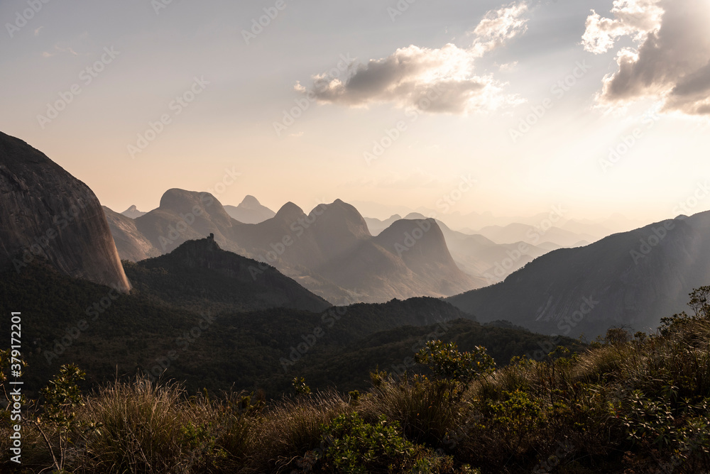 Fototapeta Beautiful view to layers of mountains on green rainforest