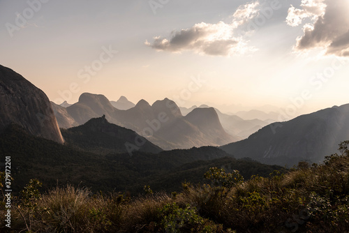 Beautiful view to layers of mountains on green rainforest