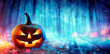 canvas print picture Pumpkin In Defocused Spooky Forest At Night - Halloween Concept