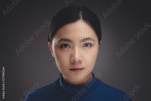 Fototapeta Close up shot of portrait Asian woman and technology scanning face. obraz