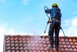 Fototapeta Kawa jest smaczna - worker washing the roof with pressurized water