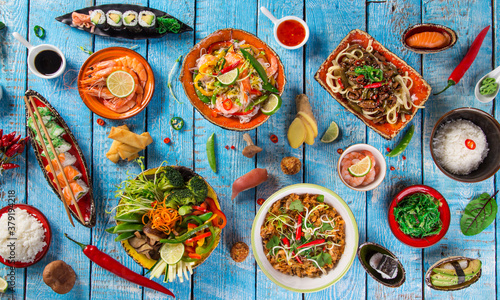 Fototapeta Asian food background with various ingredients on rustic wooden background , top view. Vietnam or Thai cuisine. obraz