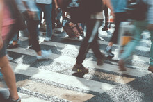 Blurred People Walk The Sunny City Toned