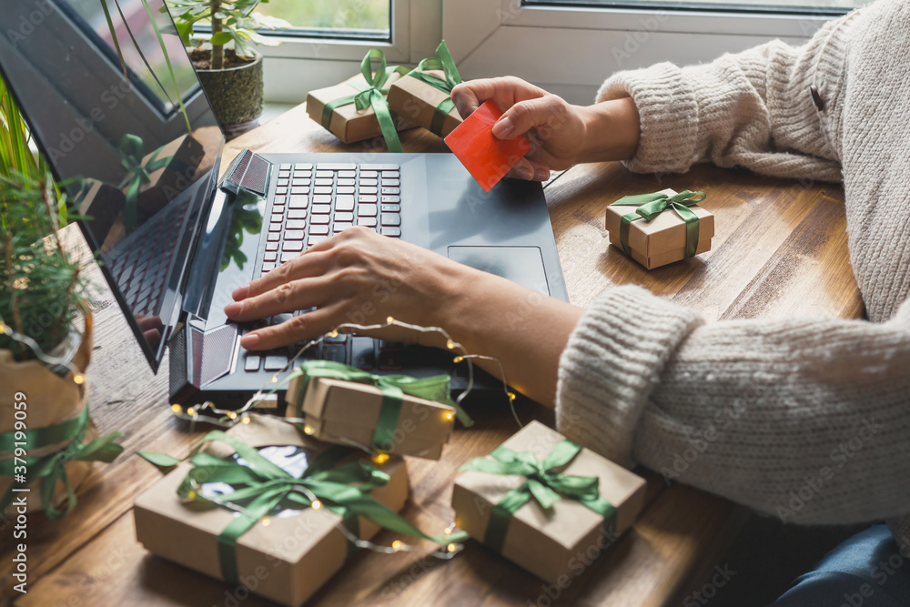 Fototapeta Christmas online shopping, sales and discounts promotions during the Christmas holidays, online shopping at home and lockdown coronavirus.Xmas