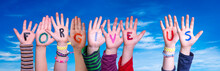 Children Hands Building Colorful English Word Forgive Us. Blue Sky As Background