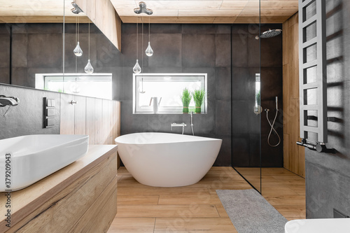Stylish bathroom with wooden and concrete walls and white bath Fototapete