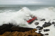 Part Of Cargo Ship Stranded On Rocks
