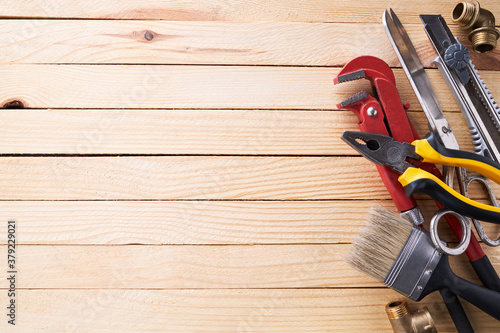 Cuadros en Lienzo handyman and repairman accessories for repairing on a wooden desk background