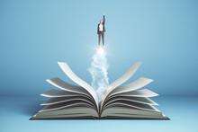 Businesswoman  Flies Over Open Book On Blue Background.
