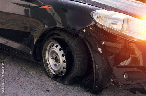 Fototapeta Accident on the road with damage to the car. knocked wheel. obraz
