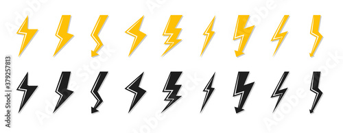 Fototapeta Set of black and yellow lightning bolt icon. Electrical strike sign or energy symbol and thunder electricity. Template logo voltage, power speed. Flash emblem shiny shock Isolated vector illustration obraz